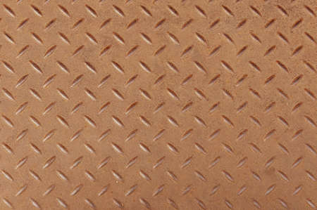 Top view of Slightly rusted steel diamond pattern sheet as background.