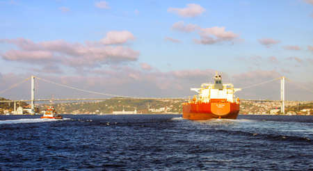 Bosphorus, Istanbul, Turkey October 24th, 2019: NS Creation Monrovia owned by Russian SCF Novoship going up the Bosphorus, to the Black Sea, accompained by a coastal safety tugboat.