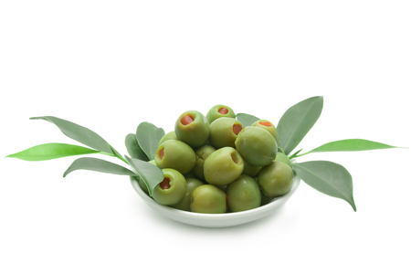 healthful: pickled green olives in bowl on white background