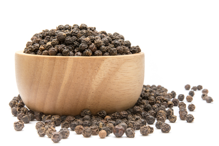 Black pepper in wooden bowl isolated on white background Stock Photo