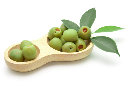 healthful: green olives in bowl on white background Stock Photo