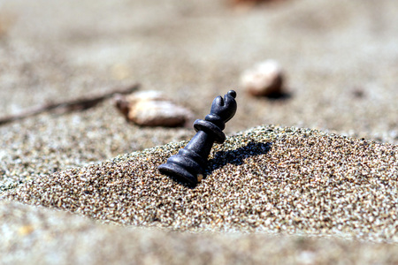 chess piece Queen in the sand