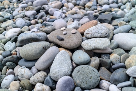 the sun of pebbles on the beach Stock Photo