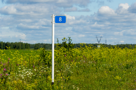 road sign mileage installed in the field