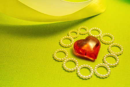 curving the glass ribbon and heart on a green background, a Declaration of love and congratulations, feelings love