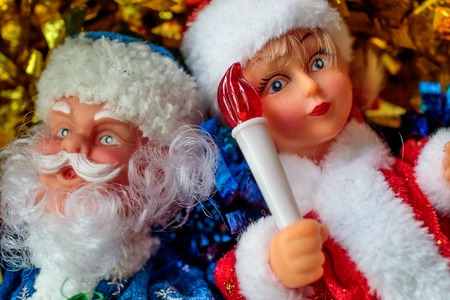 Grandfather frost and snow maiden with a toy in the hand of the snow maiden torch, Christmas mood