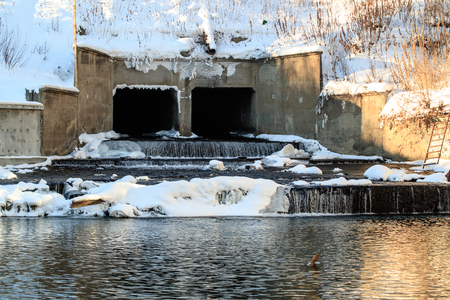 old dam in winter, snow and ice for water, winter