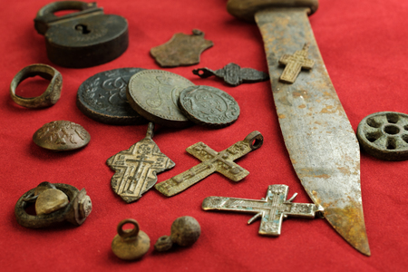 a lot of ancient copper and iron objects on a red background, personal items of the 18th century Stock Photo