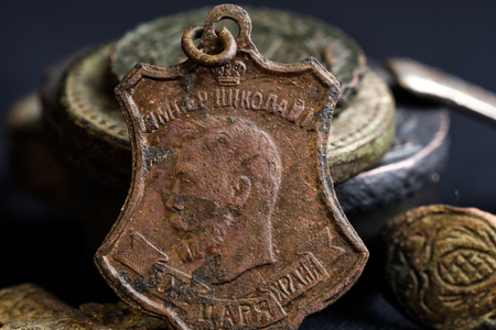 God save the king is written on the copper icon of the Emperor Nicholas II