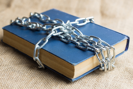 the book is chain-wound crosswise on a burlap of light brown