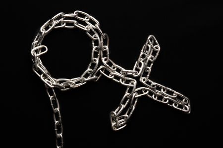 Female symbol of a metal chain on a black background