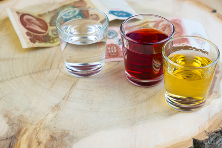 money for a drink on a wooden table in the background Stock Photo