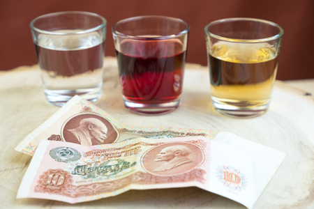 three glasses with alcohol on a cut of a tree instead of a tray in a restaurant Stock Photo