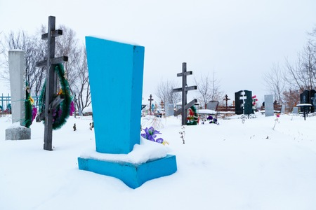 blue burial place in the cemetery in the winter in the Russian