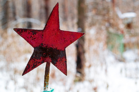 red star preserved in the cemetery from the Soviet Union, the burial of Soviet soldiers in the forest during