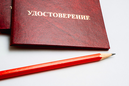 Inscription in Russian Identification of red crusts lie on a table with a pencil of red