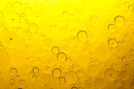 orange bubbles of oil on the water, a lot of round shapes and texture of bubbles Stock Photo