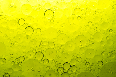 yellow bubbles on water, oil diffused on water texture of bubbles