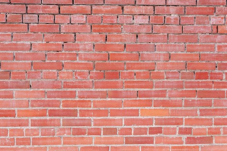 red brick wall is folded very badly, in some places there is no cement bricks crookedly laid Фото со стока