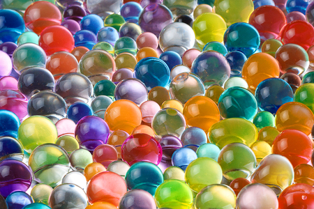 contrasting hydrogel balls, bright juicy balls in a huge amount