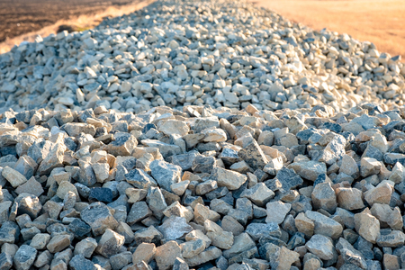 crushed stone for building a road that extends into the distance