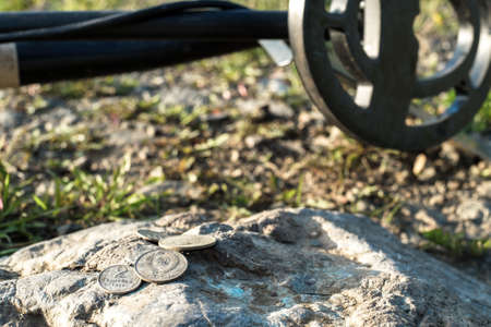 metal detector and old coins of the USSR times on the stone, the results of the coin search