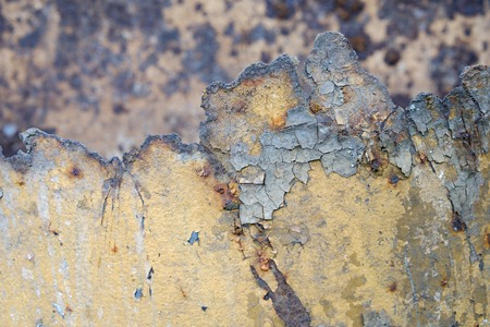 broken off old rusty iron surface with notches, old peeling paint