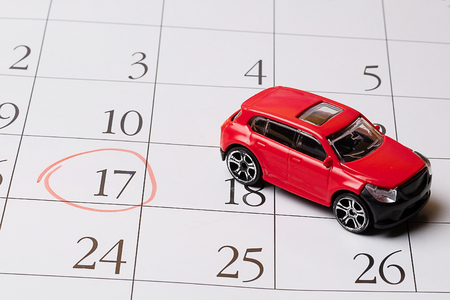 red toy car is located on the calendar, the number 17 is circled in red marker