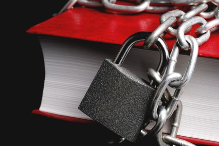 part of the red book which has a chain connected to the chain hanging lock, a metal chain with a glare