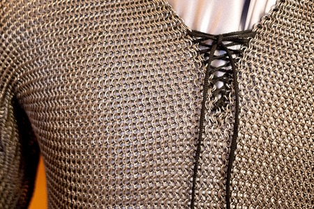 the chest part of the chain mail in a small ring of metal shape, old chain mail from the middle ages