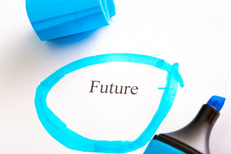 the future is written on white paper and circled in blue, the marker is blue next to the word