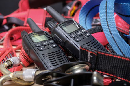 walkie-talkies and equipment for industrial mountaineering, red ropes and connections