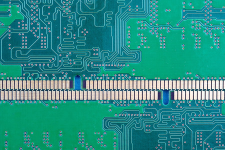 horizontal background of the computer Board with tracks and contacts, memory close-up green
