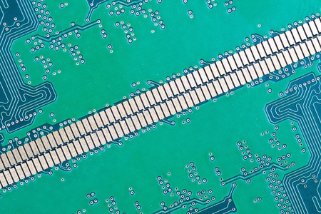 the diagonal of the contacts on the background of the green chip Board sa tracks and contacts