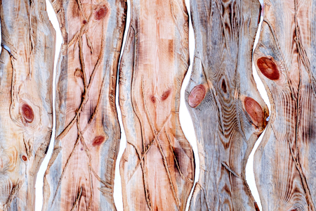 background of undulating curved wooden planks annealed to impart a texture