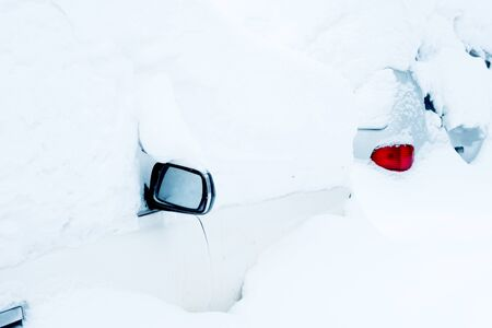 car under a thick layer of snow can be seen mirror