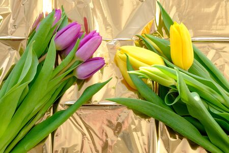 gift bouquets of flowers in shiny shiny crumpled paper
