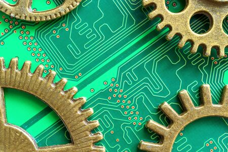 old technology of mechanical gears made of brass and modern computer chip technology