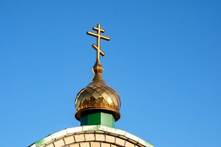 dome of the Orthodox Church with a cross against the blue sky. the Russian Church and the sky Stok Fotoğraf