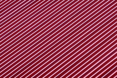 abstract background with periodic alternation of wavy metal roof diagonal waves go up. metal roof red