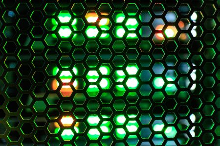through the mesh consisting of hexagonal shapes flickering signal LEDs. transparent hexagonal station equipment standing in the closet telecommunication technologies
