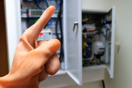the index finger in the dielectric rubber glove is raised up. caution before starting work with electricity wear gloves