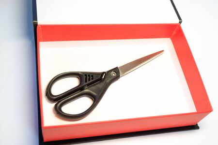 scissors with black handles are in a red box. gift option random lottery
