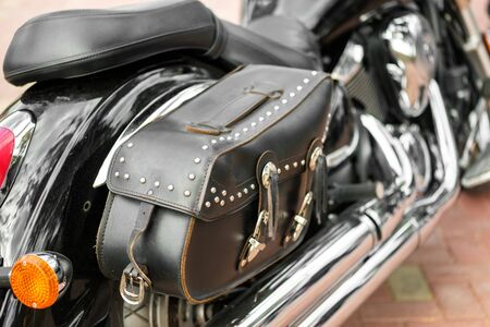 the back of the motorcycle with a leather bag on the side next to the passenger seat. travel on a big motorcycle Reklamní fotografie