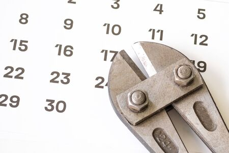 big dirty scissors for snapping metal rods on a calendar sheet. planning a job or a robbery Banco de Imagens