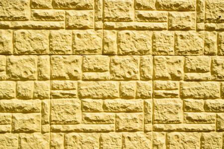 close up of decorative yellow tiles pasted on the wall of the buildings facade Stock fotó