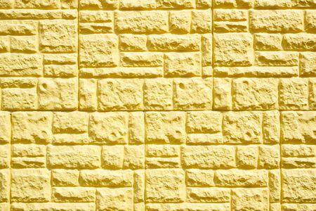 yellow decorative tile wall cladding. texture of decorative yellow brick