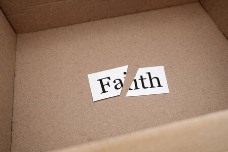 cut the word faith in an open box of beige color. a package came with a circumcised faith