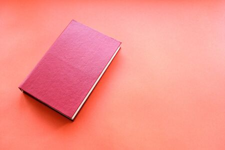 red book on a red background in hardcover. literature red book