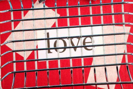 love behind bars of metal on a red background. love went to jail Zdjęcie Seryjne